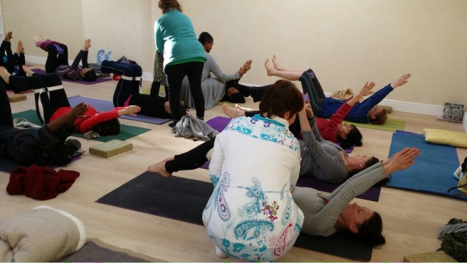 yoga teachers assisting the practice